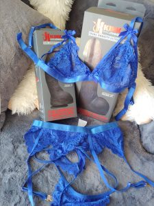 Blue lingerie displayed over two BBC dildos